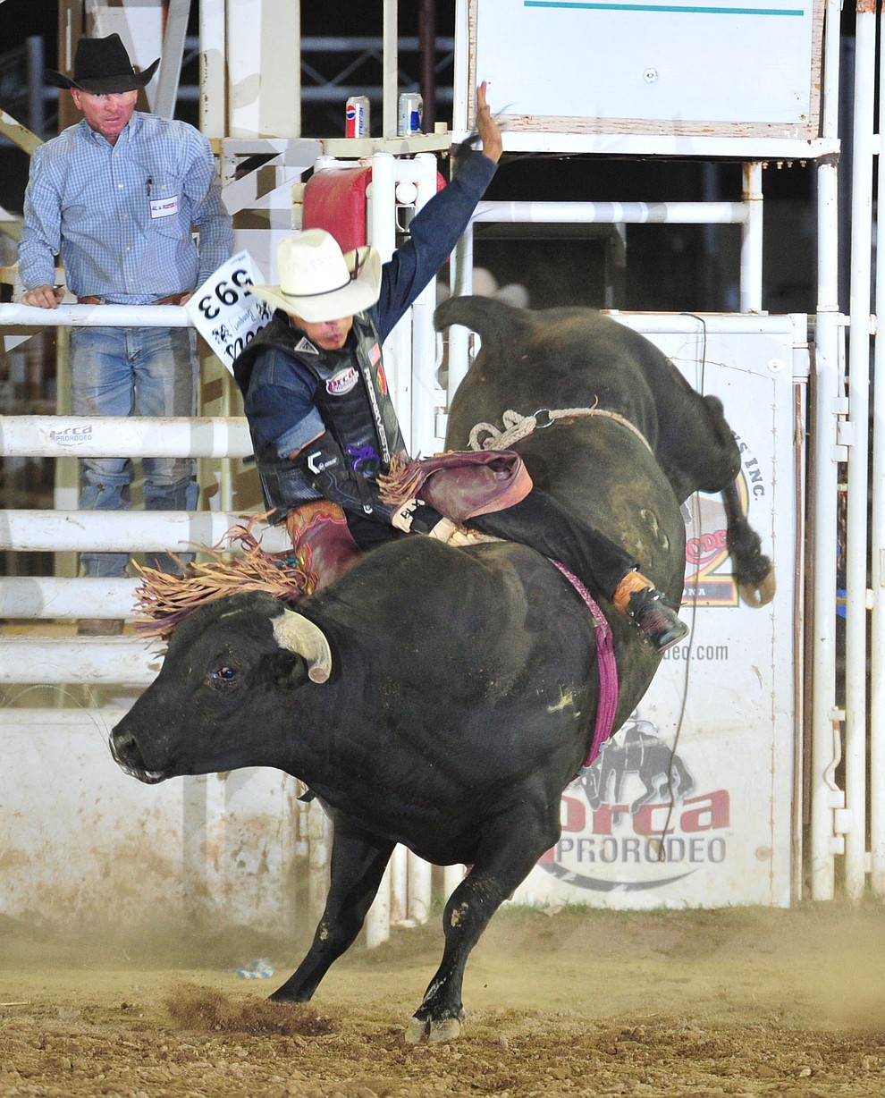 Dugan Black gets off center on Ferdinand in the bull riding during the 5th performance of the Prescott Frontier Days Rodeo Sunday, July 1, 2018. (Les Stukenberg/Courier)