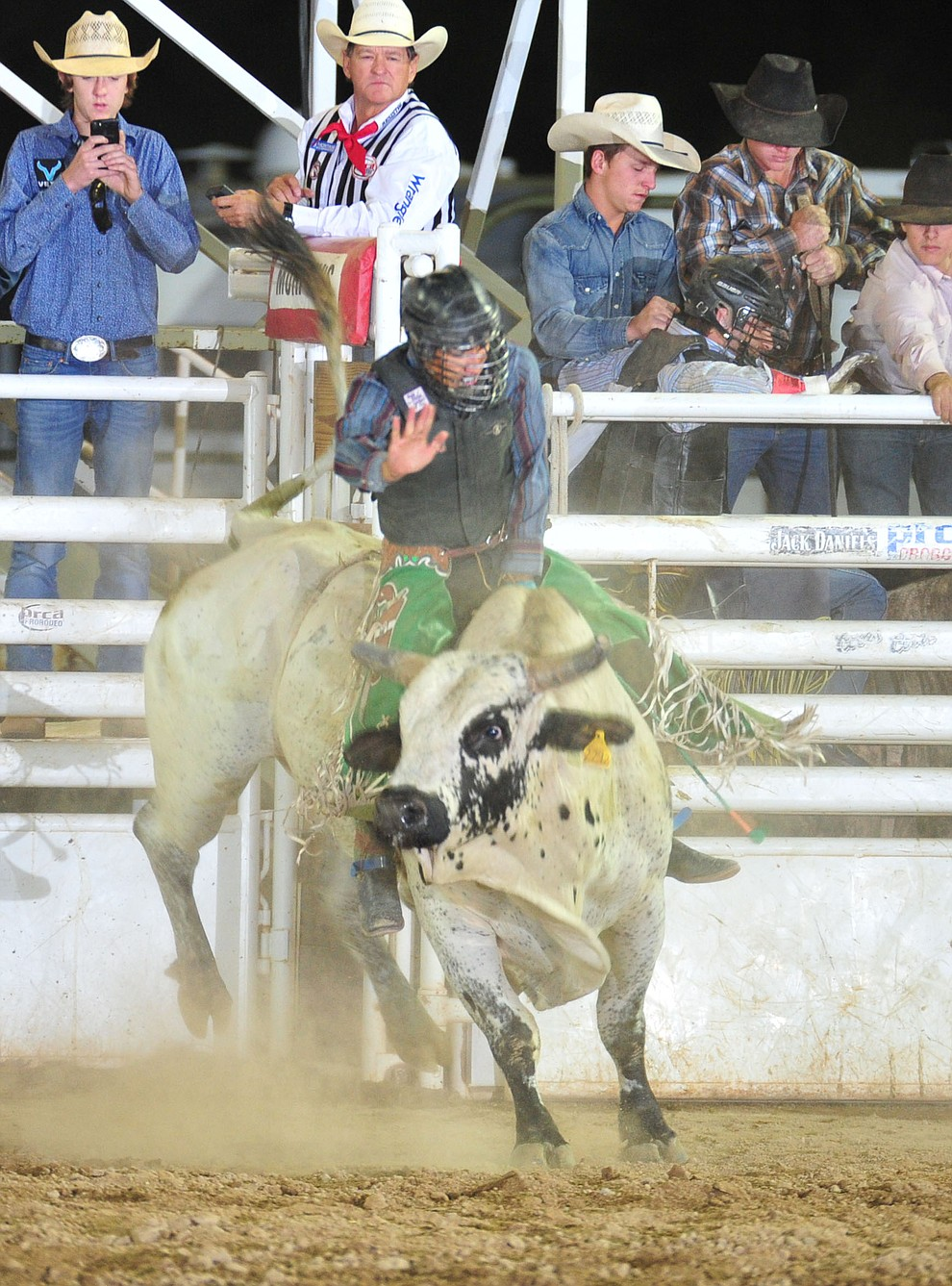 Wyatt Nez on Blue Moon in the bull riding during the 5th performance of the Prescott Frontier Days Rodeo Sunday, July 1, 2018. (Les Stukenberg/Courier)