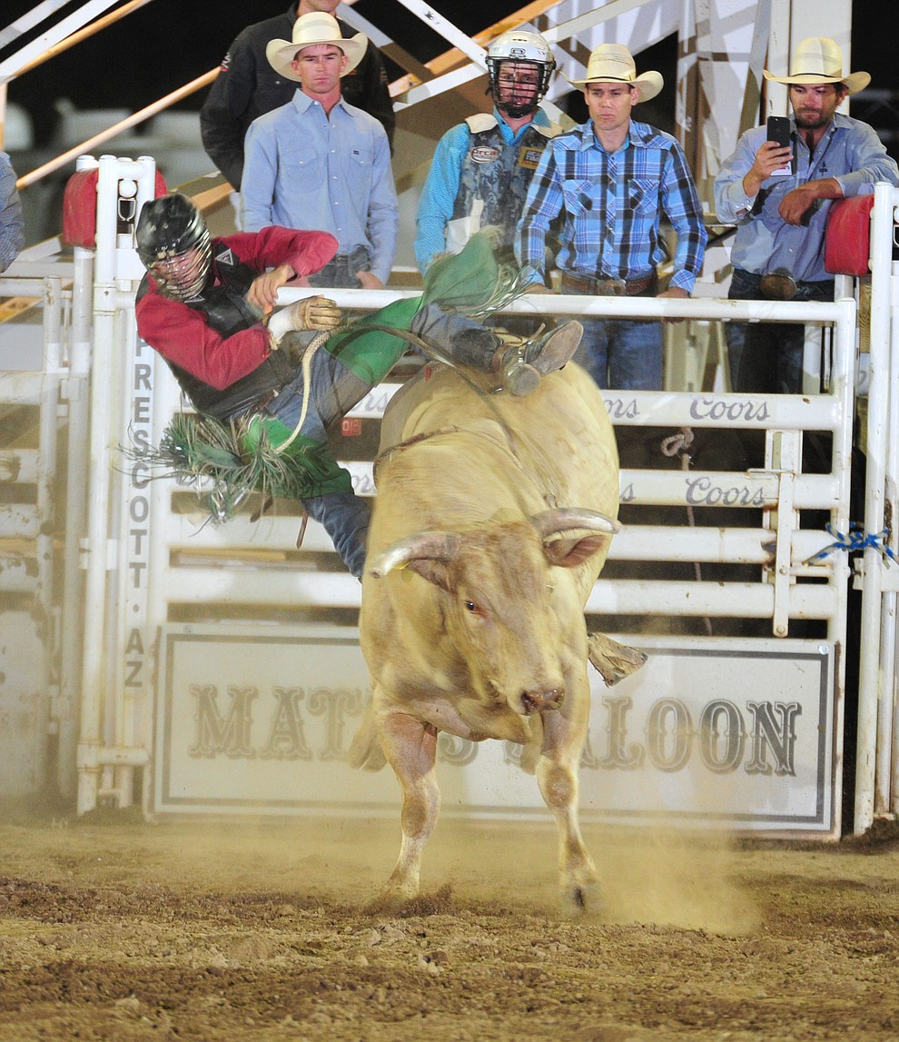 Jeff Askey on Rodeo Houston in the bull riding during the 5th performance of the Prescott Frontier Days Rodeo Sunday, July 1, 2018. (Les Stukenberg/Courier)