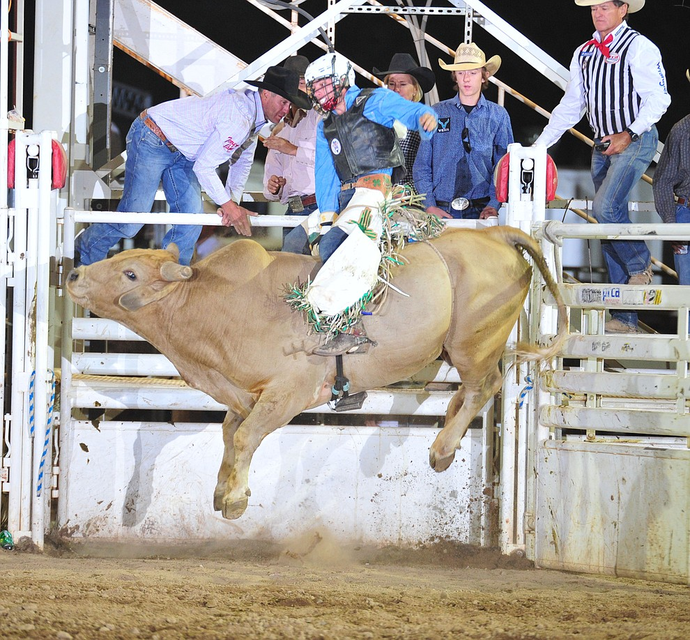 Justin Neill on Olohanta in the bull riding during the 5th performance of the Prescott Frontier Days Rodeo Sunday, July 1, 2018. (Les Stukenberg/Courier)