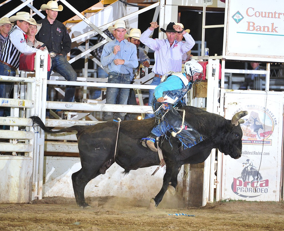 Dave Mason on County Sheriff in the bull riding during the 5th performance of the Prescott Frontier Days Rodeo Sunday, July 1, 2018. (Les Stukenberg/Courier)