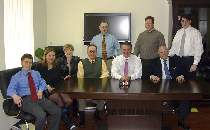 Konstantin Kilimnik, an elusive figure under indictment for alleged witness tampering by Special Counsel Robert Mueller, is seen seated on the far left in a March 2006 photo obtained by The Associated Press as part of a collection of internal corporate memos and business records from the international political consulting offices of Donald Trump's ex-campaign chairman, Paul Manafort. Mueller has indicated that Kilimnik is in Russia and has ties to Russian intelligence, which Kilimnik disputes. The photograph represents one of the few images known to exist of Kilimnik. Also in the photo, seated from left: Kilimnik, Martha Young, Catherine Barnes, Tad Devine, Paul Manafort, Phillip Griffin; standing from left: Lee Avrashov, an unidentified individual and Christian Ferry. (via AP)