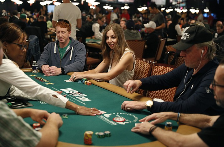 Maria Konnikova, center, competes during the first day of the World Series of Poker main event Monday, July 2, 2018, in Las Vegas. (John Locher/AP Photo)