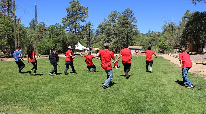 Juvenile probationers participating in Youth STEP play a team-building game Tuesday morning, June 19, at Chapel Rock Camp and Conference Center in Prescott. Max Efrein/The Daily Courier