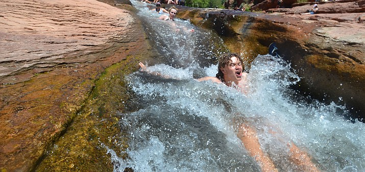 Oak Creek provides a refreshing burst of water carrying swimmers like a runaway train into refreshing pools of water under spectacular views at SlideRock State Park. VVN/Vyto Starinskas