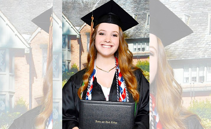 Laura Davis graduates Magna Cum Laude