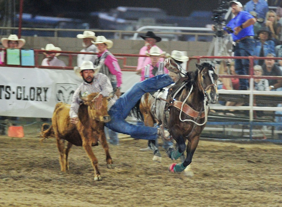 Andrew Galloway gets a 7.5 second run in the steer wrestling during the 6th performance of the Prescott Frontier Days Rodeo Monday, July 2, 2018. (Les Stukenberg/Courier)