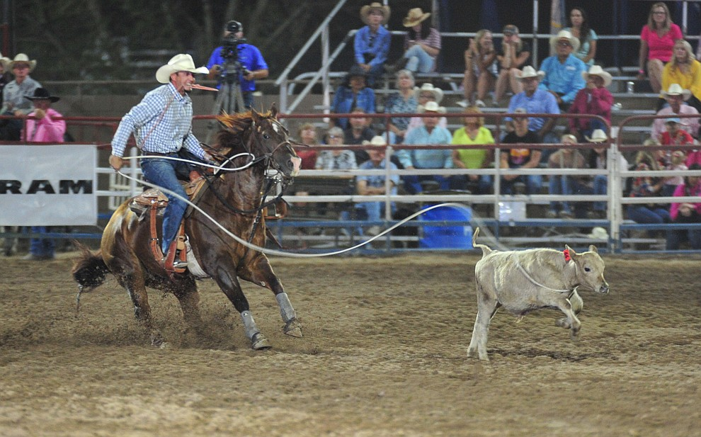 Seth Hall runs 11.2 in the tie down roping during the 6th performance of the Prescott Frontier Days Rodeo Monday, July 2, 2018. (Les Stukenberg/Courier)