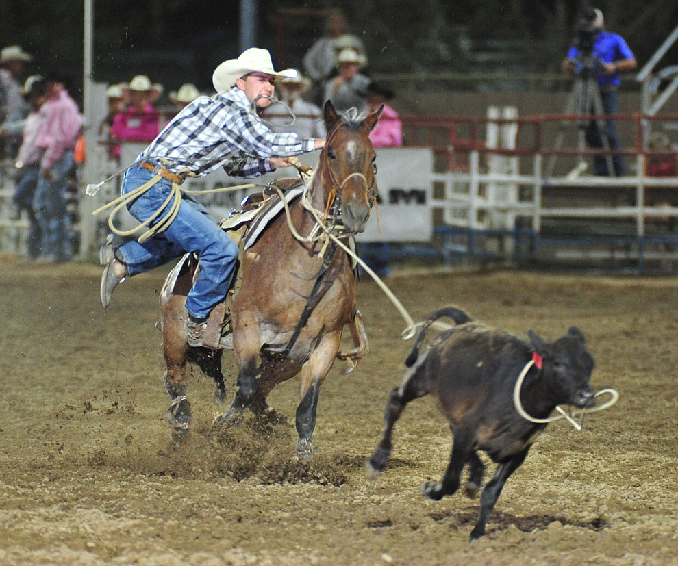 Colter Sellers runs 12.9 in the tie down roping during the 6th performance of the Prescott Frontier Days Rodeo Monday, July 2, 2018. (Les Stukenberg/Courier)