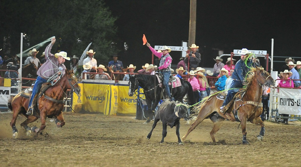 Nate Singletary and Tom Bill Johnson ran 8.6 seconds in the team roping during the 6th performance of the Prescott Frontier Days Rodeo Monday, July 2, 2018. (Les Stukenberg/Courier)