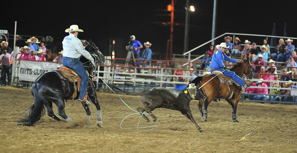 Aaron Tsinigine and Trey Yates run 8.7 seconds in the team roping during the 6th performance of the Prescott Frontier Days Rodeo Monday, July 2, 2018. (Les Stukenberg/Courier)