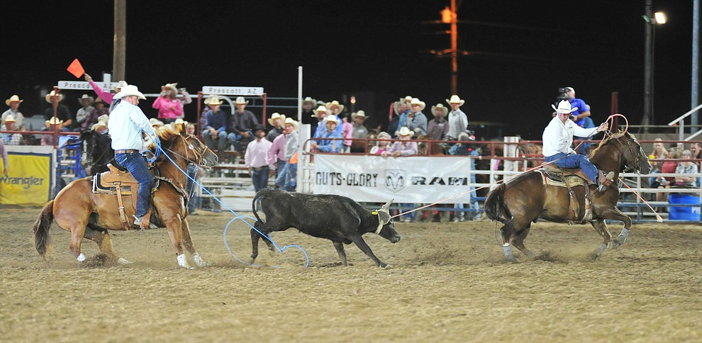 Clay Tryan and Travis Grave are 6.9 seconds in the team roping during the 6th performance of the Prescott Frontier Days Rodeo Monday, July 2, 2018. (Les Stukenberg/Courier)