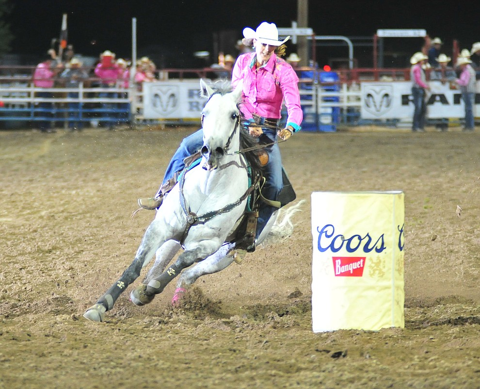 Laura Carmen is 22.89 seconds with a penalty in the barrel race during the 6th performance of the Prescott Frontier Days Rodeo Monday, July 2, 2018. (Les Stukenberg/Courier)