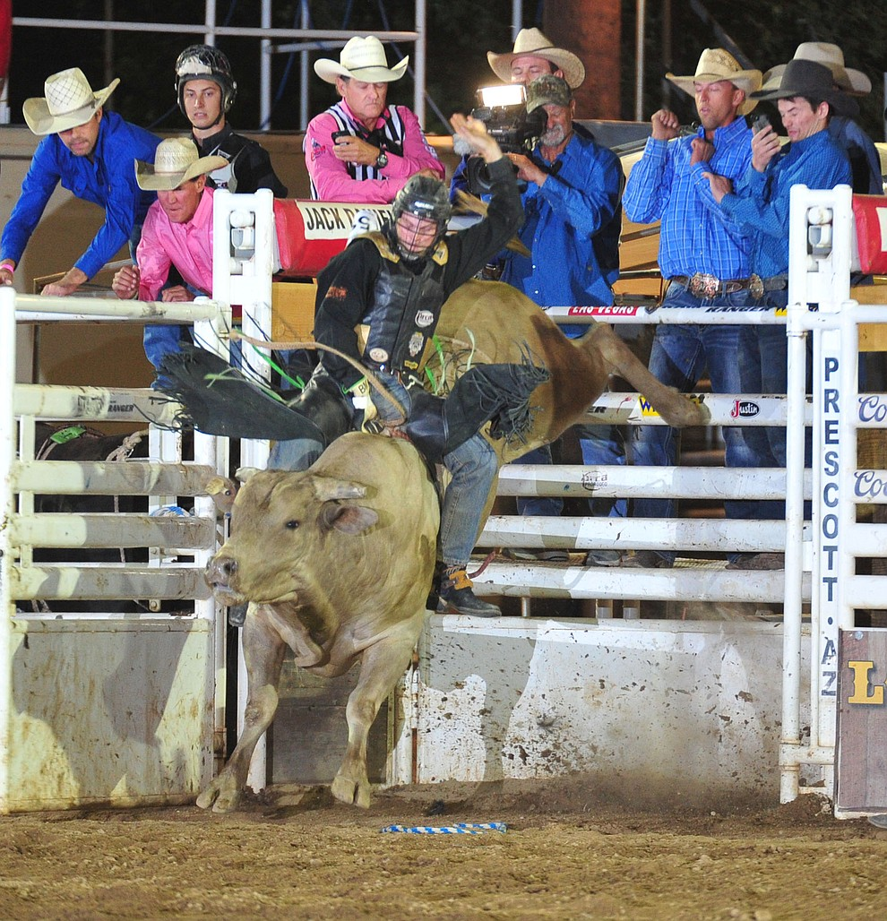 Brandon McCassie on Crazy Nights in the bull riding during the 6th performance of the Prescott Frontier Days Rodeo Monday, July 2, 2018. (Les Stukenberg/Courier)