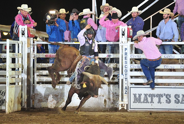 Tim Bingham scores 89.5 on Monte Walsh to take the overall lead in the bull riding during the 6th performance of the Prescott Frontier Days Rodeo Monday, July 2, 2018. (Les Stukenberg/Courier)