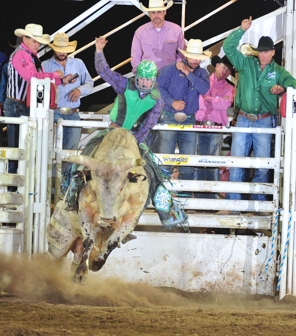 Carston Smith on Yikes in the bull riding during the 6th performance of the Prescott Frontier Days Rodeo Monday, July 2, 2018. (Les Stukenberg/Courier)