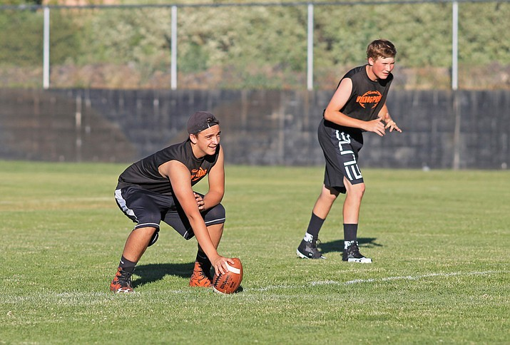 Xavier Leonet and Cody Jensen participate in a 5-on-5 summer passing league at Williams High School.