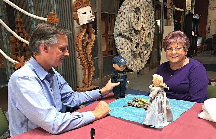 Sean Morton looks at antiques with Old Trails Museum volunteer Debbie Roberts. (Photo courtesy Old Trails Museum)