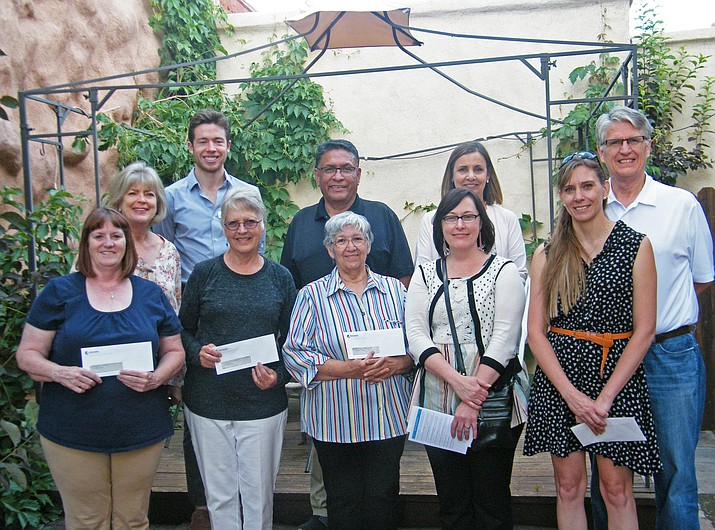 The Greater Williams Community Fund presented annual grants June 14 at Anna's Canyon Cafe. Grantees included (from left) Theresa Johnson, Williams Police Department; Kris Williams, Williams Alliance for the Arts, Delores Paredes, Williams Senior Center; Carissa Morrison, Williams Unified School District, Jen Ringe, Victim Witness Services of Coconino County (back row, from left) Linda Eaton, GWCF steering committee, Steven Murphy-Logue, Big Brothers, Big Sisters; Steve Peru, United Way of Northern Arizona, Kindercamp; Liz Burke, Girls on the Run and Chuck Eaton, GWCF steering committee. A representative from the Phoenix Science Center was unable to attend. (Submitted photo)