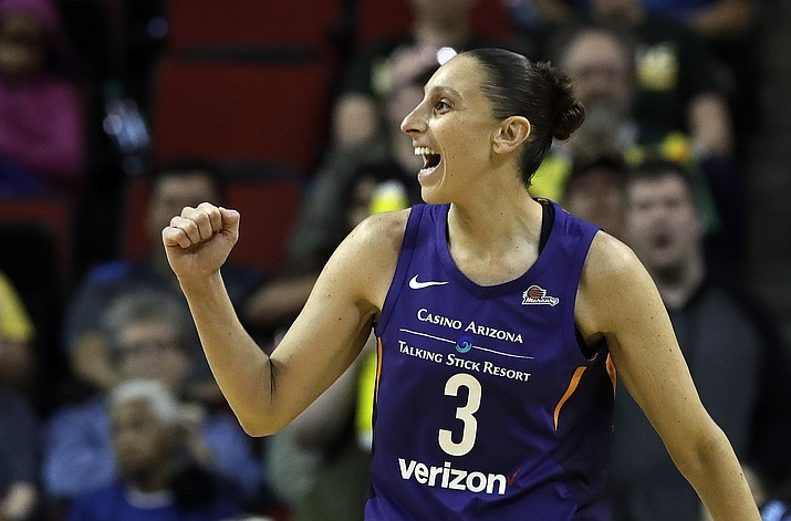 In this May 20, 2018, file photo, Phoenix Mercury's Diana Taurasi reacts to a call in their favor against the Seattle Storm in the first half of a WNBA basketball game, in Seattle. The WNBA season is nearing its midway point and it's probably no surprise that Phoenix, Los Angeles and Seattle are at the top of the standings. (Elaine Thompson/AP, File)
