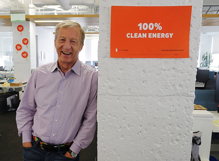 In this photo taken Wednesday, June 27, 2018, environmental activist & billionaire Tom Steyer poses at his offices in San Francisco. Arizona's largest utility is fiercely opposing a push to mandate increased use of renewable energy in the sun-drenched state, setting up a political fight over the measure funded by Steyer. (AP Photo/Eric Risberg)