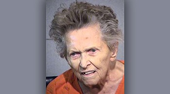 Pleas entered for 92-year-old woman held in son's death photo