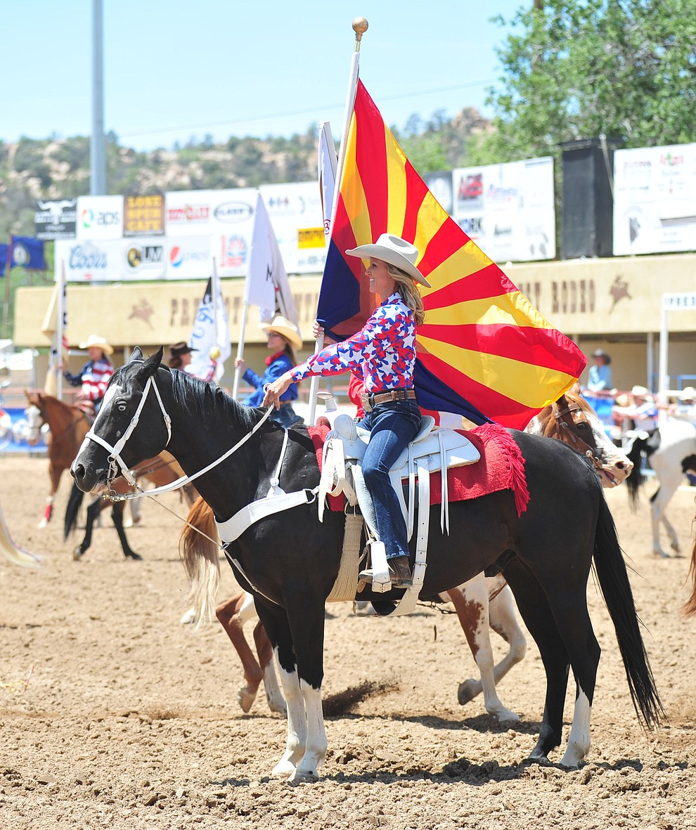 Kimberly Harmon holds the Arizona flag in the Grad Entry during the final performance of the 2018 Prescott Frontier Days Rodeo Wednesday, July 4, 2018. (Les Stukenberg/Courier)