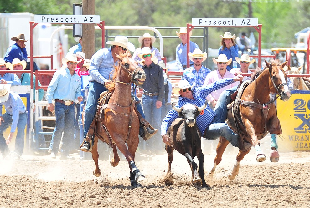 Dean McIntyre in the steer wrestling during the final performance of the 2018 Prescott Frontier Days Rodeo Wednesday, July 4, 2018. (Les Stukenberg/Courier)