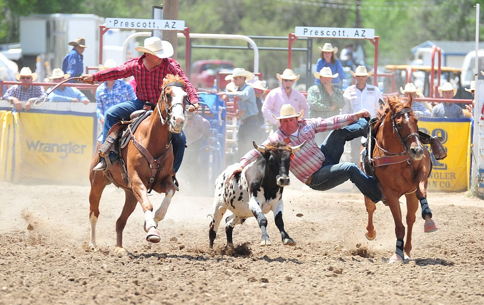 Wyatt Smith in the steer wrestling during the final performance of the 2018 Prescott Frontier Days Rodeo Wednesday, July 4, 2018. (Les Stukenberg/Courier)