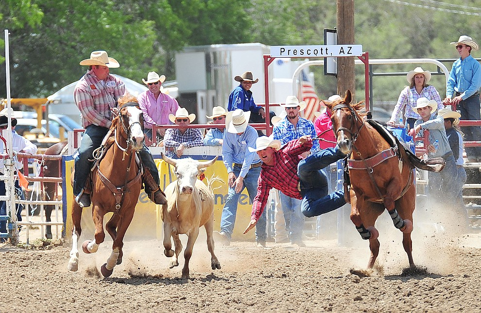 Trey Nehrgang in the steer wrestling during the final performance of the 2018 Prescott Frontier Days Rodeo Wednesday, July 4, 2018. (Les Stukenberg/Courier)