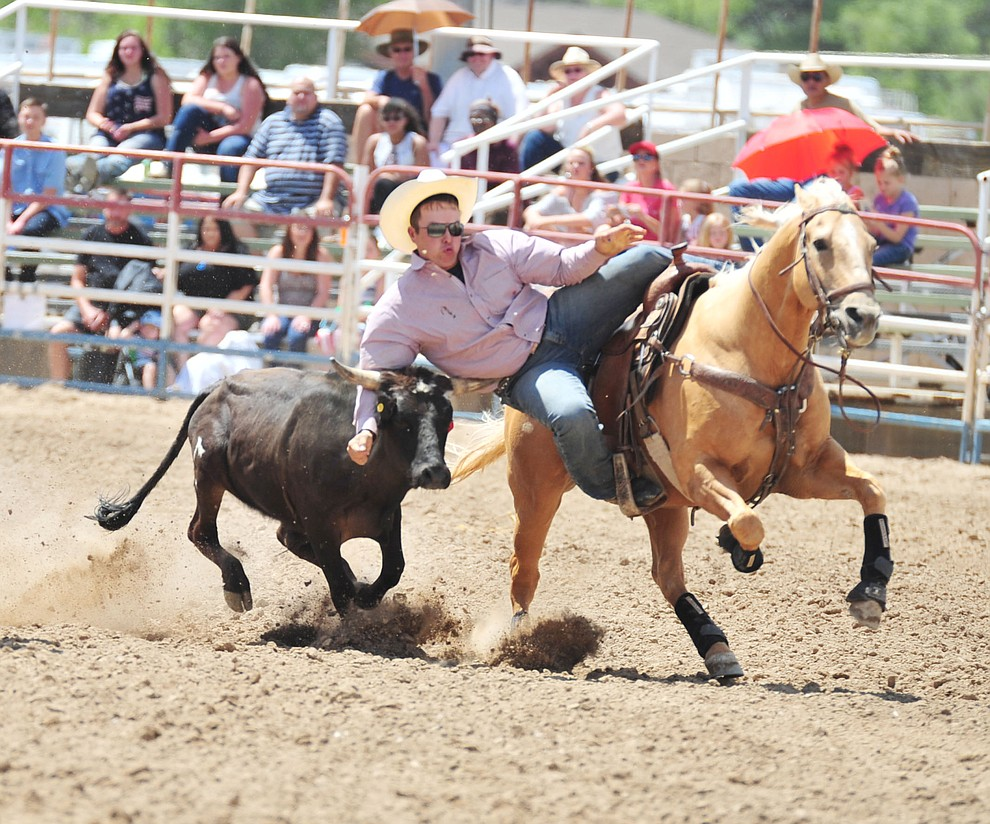 Derek Worthen in the steer wrestling during the final performance of the 2018 Prescott Frontier Days Rodeo Wednesday, July 4, 2018. (Les Stukenberg/Courier)