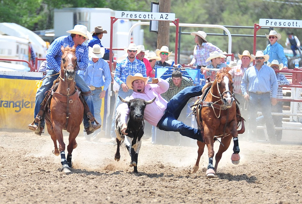 Trey Robertson in the steer wrestling during the final performance of the 2018 Prescott Frontier Days Rodeo Wednesday, July 4, 2018. (Les Stukenberg/Courier)