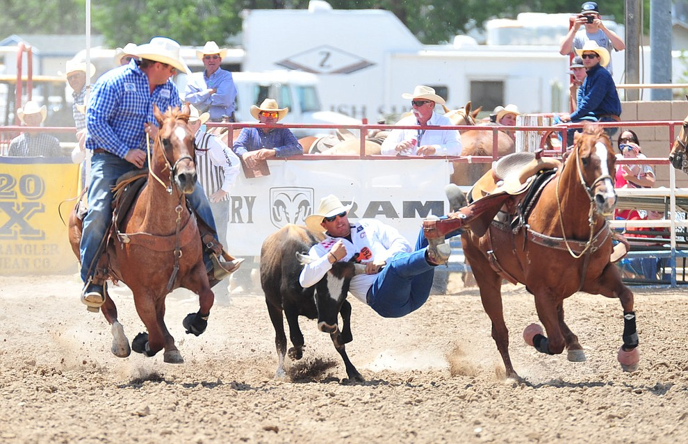 Trevor Knowles in the steer wrestling during the final performance of the 2018 Prescott Frontier Days Rodeo Wednesday, July 4, 2018. (Les Stukenberg/Courier)