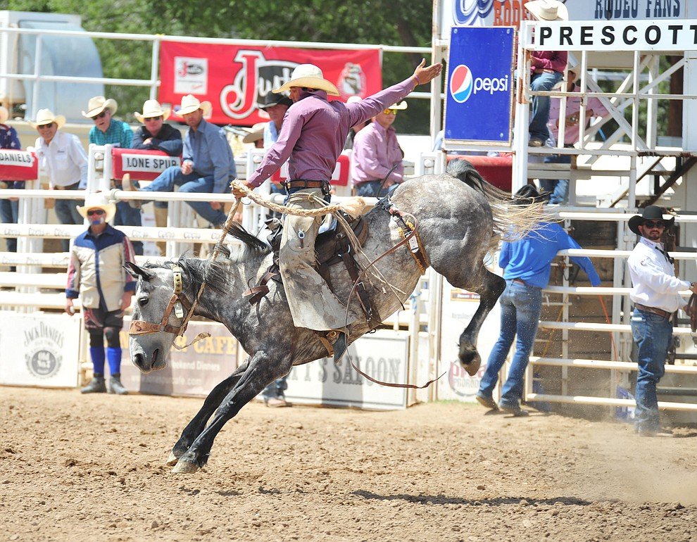 Ty Smith on Suzie Q in the Cowpunchers Bronc Riding during the final performance of the 2018 Prescott Frontier Days Rodeo Wednesday, July 4, 2018. (Les Stukenberg/Courier)