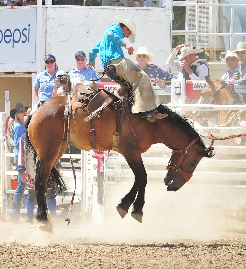 Tanner Blunk on Post Time in the Cowpunchers Bronc Riding during the final performance of the 2018 Prescott Frontier Days Rodeo Wednesday, July 4, 2018. (Les Stukenberg/Courier)