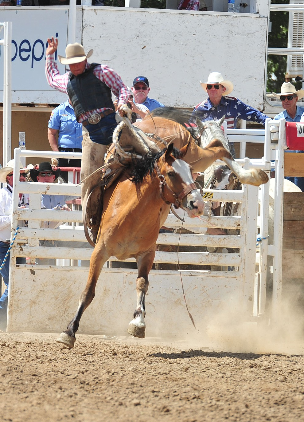Will Vest on Well Armed in the Cowpunchers Bronc Riding during the final performance of the 2018 Prescott Frontier Days Rodeo Wednesday, July 4, 2018. (Les Stukenberg/Courier)
