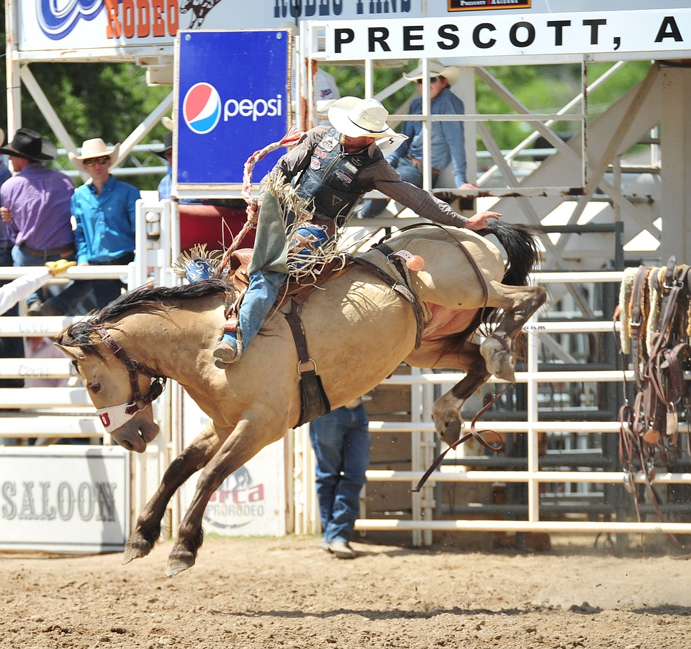 Zachariah Phillips on Smoke Jumper in the Saddle Bronc Riding during the final performance of the 2018 Prescott Frontier Days Rodeo Wednesday, July 4, 2018. (Les Stukenberg/Courier)