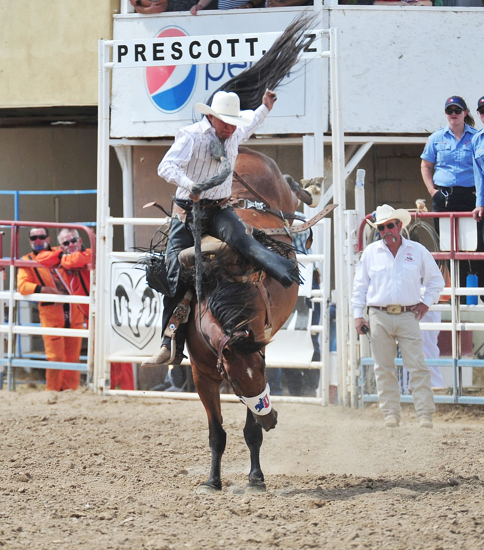 Creighton Curley on Mustachio in the Saddle Bronc Riding during the final performance of the 2018 Prescott Frontier Days Rodeo Wednesday, July 4, 2018. (Les Stukenberg/Courier)