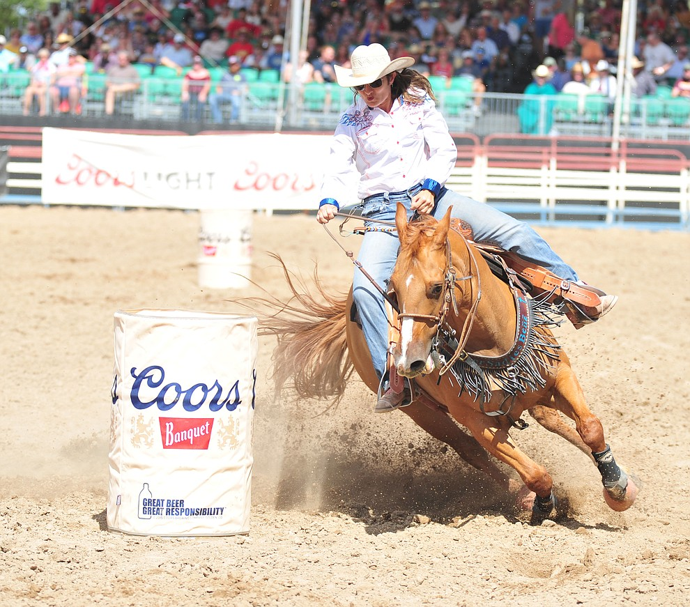 Kelly Robertson in the barrel race during the final performance of the 2018 Prescott Frontier Days Rodeo Wednesday, July 4, 2018. (Les Stukenberg/Courier)