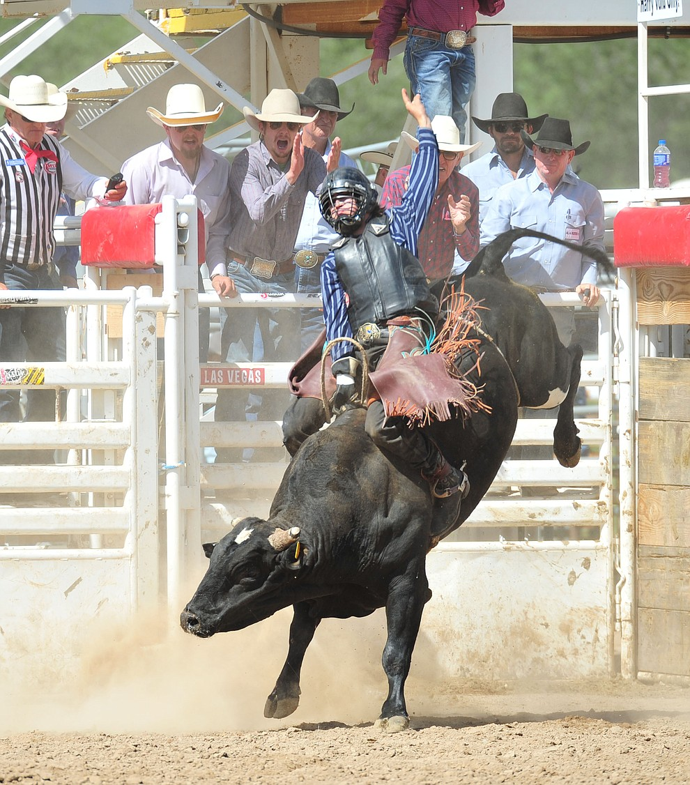 Hunter Kelly on Danger Danger in the bull riding during the final performance of the 2018 Prescott Frontier Days Rodeo Wednesday, July 4, 2018. (Les Stukenberg/Courier)