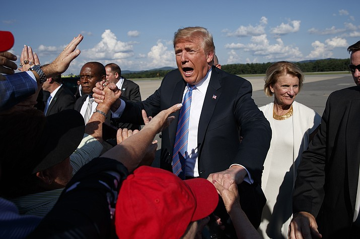 "President Donald Trump greets supporters after arriving at the Greenbrier Valley Airport in Lewisburg, W.Va., before attending a ""Salute to Service"" dinner, Tuesday, July 3, 2018, in White Sulphur Springs, W.Va. (Evan Vucci/AP Photo)"