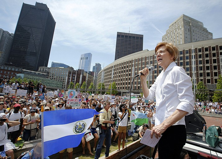 """Sen. Elizabeth Warren, D-Mass., speaks during a Rally Against Separation in Boston on June 30, 2018. The White House is using its official Twitter handle to target Democratic lawmakers who have criticized President Donald Trump's immigration policies, drawing complaints that government resources are being used to undercut potential 2020 rivals. The White House handle falsely accused California Sen. Kamala Harris on Monday of """"supporting the animals of MS-13"""" and erroneously said Warren was """"supporting criminals moving weapons, drugs, and victims"""" over the border. (Winslow Townson/AP Photo, file)"""