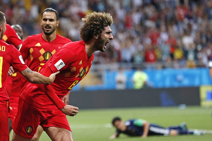 Belgium's Marouane Fellaini celebrates after scoring his side's second goal during the round of 16 match between Belgium and Japan at the 2018 soccer World Cup in the Rostov Arena, in Rostov-on-Don, Russia, Monday, July 2, 2018. (Natacha Pisarenko/AP)