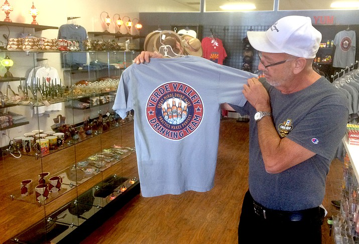 Tony Ontiveros shows off one of the Verde Valley T-shirts he is selling at his new Crazy T's Shirts and Souvenirs store in Old Town Cottonwood. VVN/Vyto Starinskas