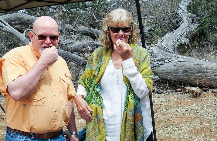 Villagers Jeanie Mintun and Luke Hippler sampling a piece of roasted agave.
