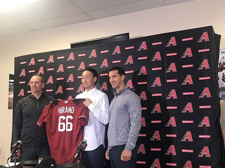 Yoshihisa Hirano poses for a photo with Diamondbacks manager Torey Lovullo and general manager Mike Hazen at Hirano's introductory press conference. He holds the Diamondbacks' scoreless game streak. (Photo by Andrew Bell/Cronkite News)