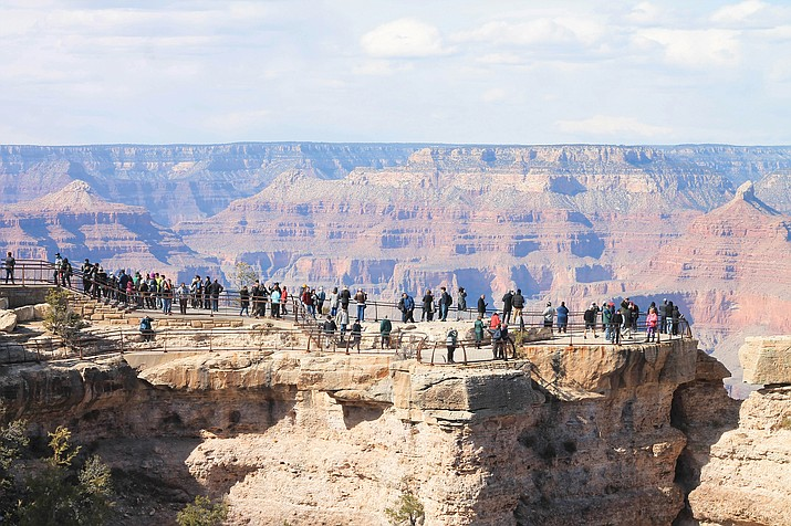 Visitors enjoy Mather Point, a scenic Grand Canyon viewpoint located along the South Rim of the canyon in Arizona. Mather Point is popular for its canyon vistas and proximity to the Visitor Center Plaza. (Loretta Yerian/Williams-Grand Canyon News)