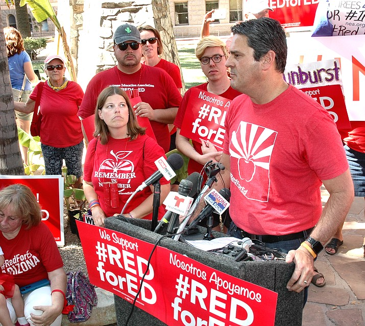 Arizona Education Association President Joe Thomas explains Thursday why teachers and their allies decided the best way to get new money into the classroom was a tax on the richest Arizonans. (Photo by Howard  Fischer/Capitol Media Services)