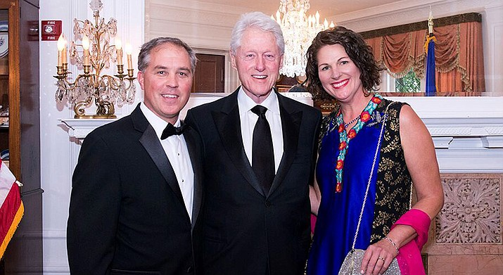 From left, Bill Carter,former US President Bill Clinton,Verde Valley School anthropology teacher Leigh Carter. Bill Carter's most recent work is with GO-Labs from MIT, and officials in Puerto Rico, to help redesign PR's electrical grid destroyed in Hurricane Maria.Courtesy photo