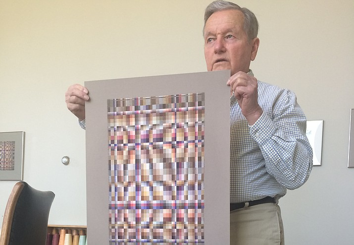 Richard Landis holds up a replica of one of his pieces currently in the Cooper Hewitt Smithsonian Design Museum located in New York City. It's one of the most complex pieces he ever created. (Jason Wheeler/Courier)
